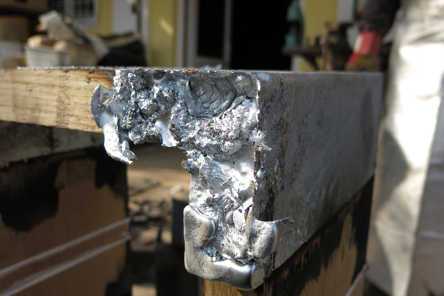 Casting Molten Metal On Wood With A Hungarian Design