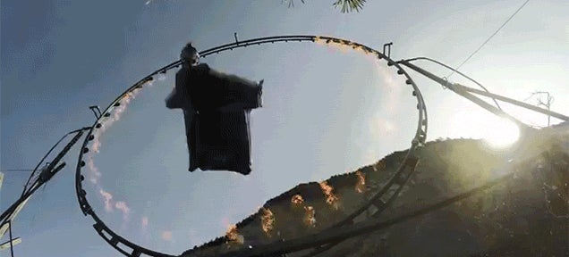 Man in Wingsuit Flies Straight Through a Ring of Fire