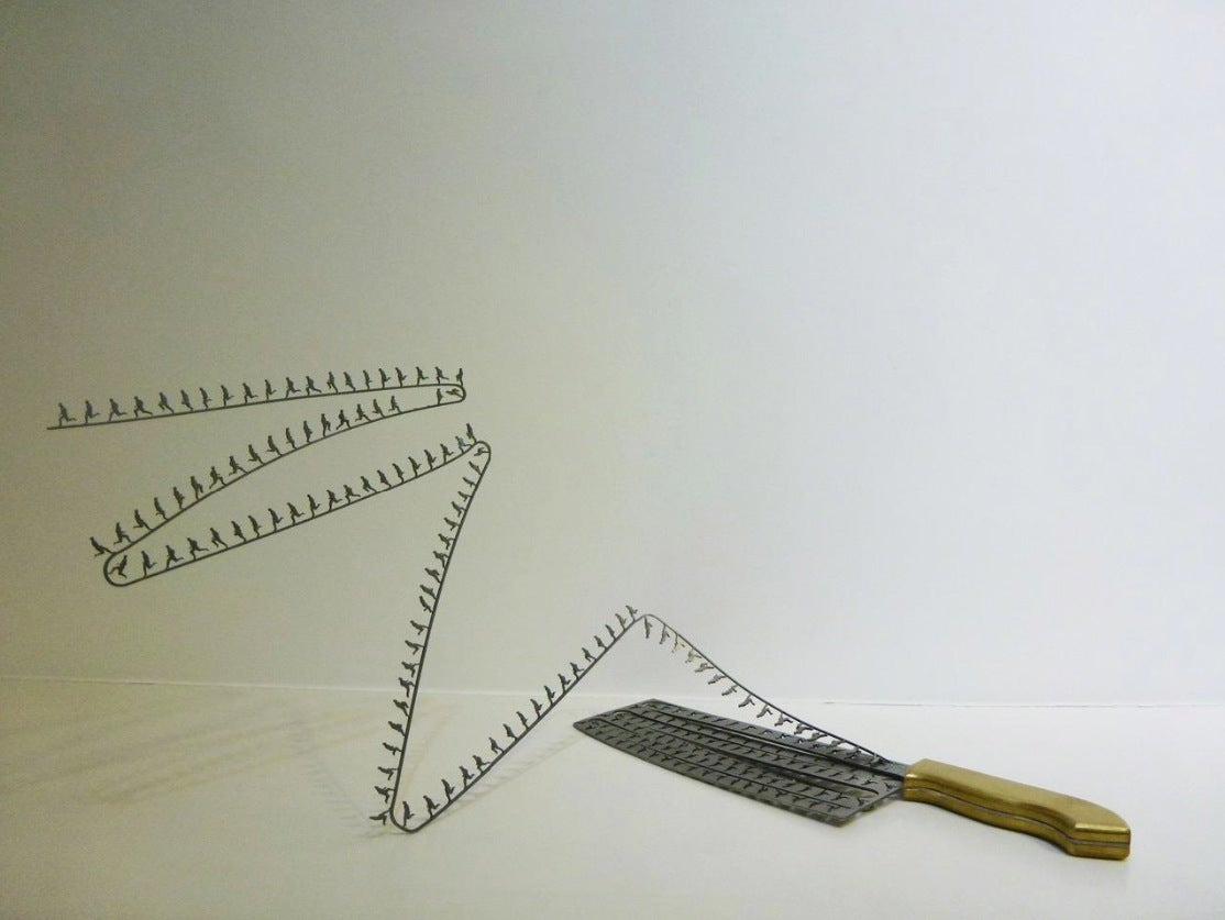 Intricate shadow silhouettes carved out of butcher's knife blades