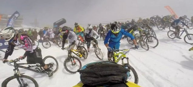 600 mountain bikers descend at once down 8,500-foot snow covered course