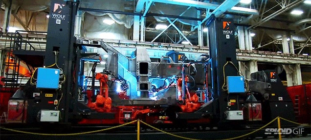 Assembling a huge Cat 797 dump truck is like building a mechanical giant